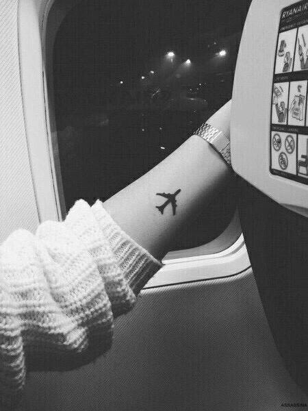 Aeroplane tattoos on arm