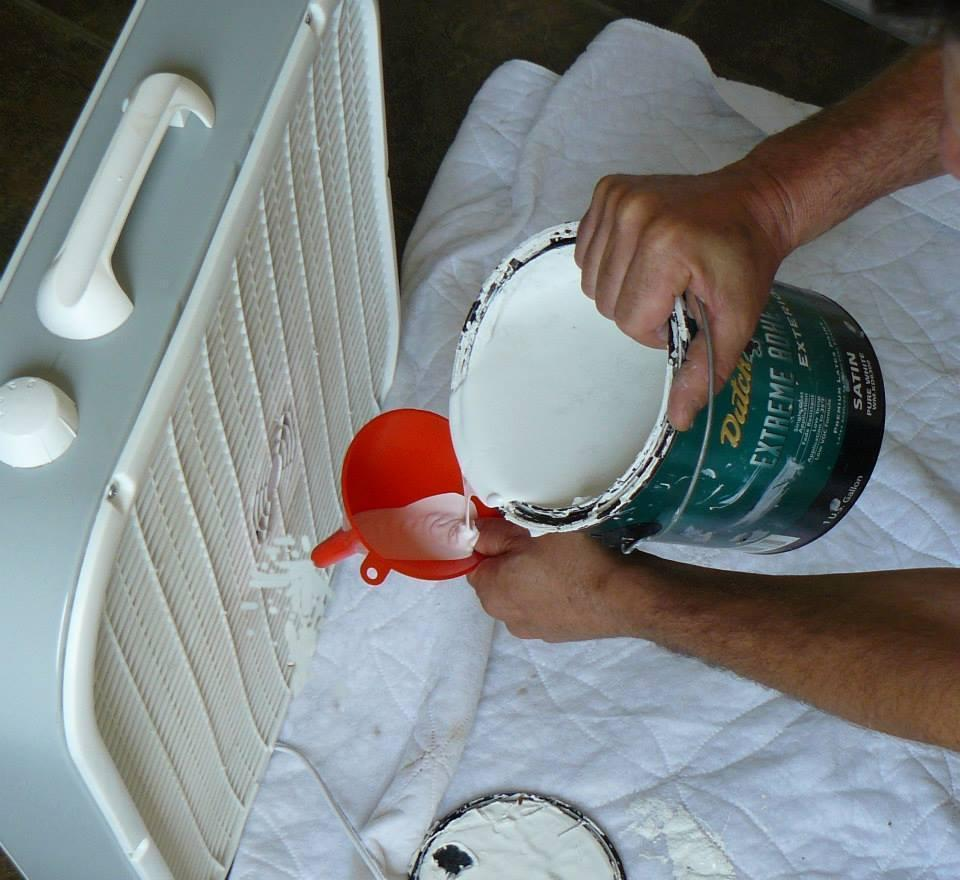 Use a high-powered box fan and funnel to quickly paint interior walls.
