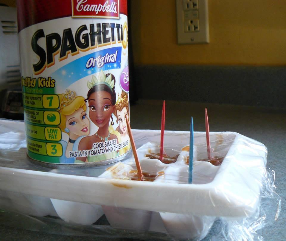 Fill ice cube trays with Spaghettio's™, cover with plastic, and ins
