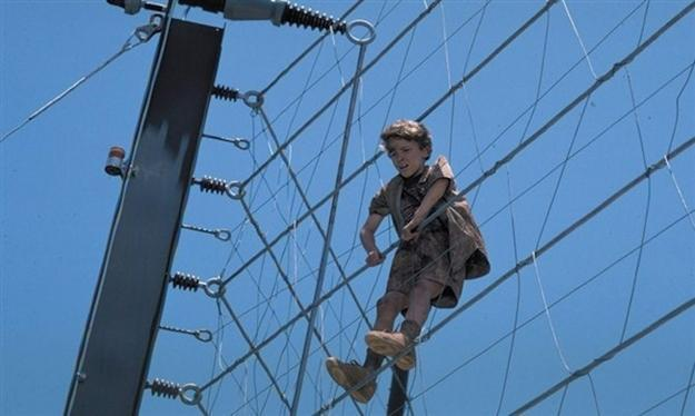 In Jurassic Park, why didn't Timmy just climb through the fence