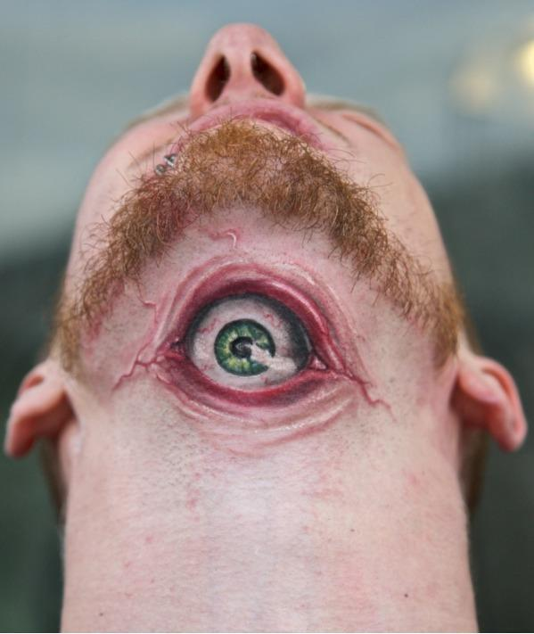 The hyper-realism of this tattoo makes you have to look twice...or thr