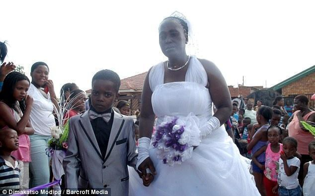 Eight-Year Old Sanele Masilela walks down the aisle with his 61-year-o