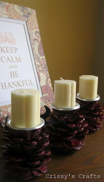 Pine cones made into candle stands. Cute