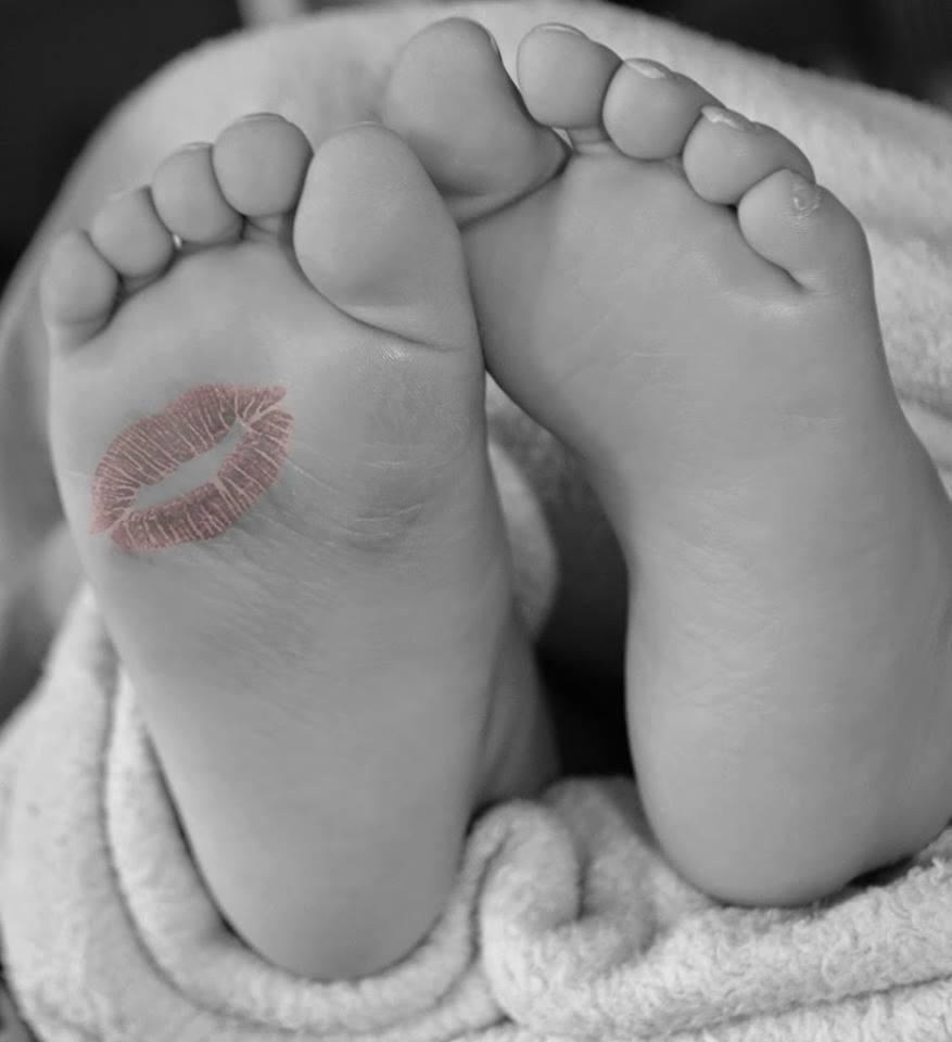 A kiss on Tiny Little Baby Feet