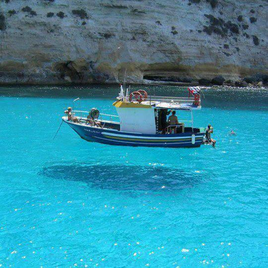 The water is so clear it looks like the boat is hovering! Any guess on