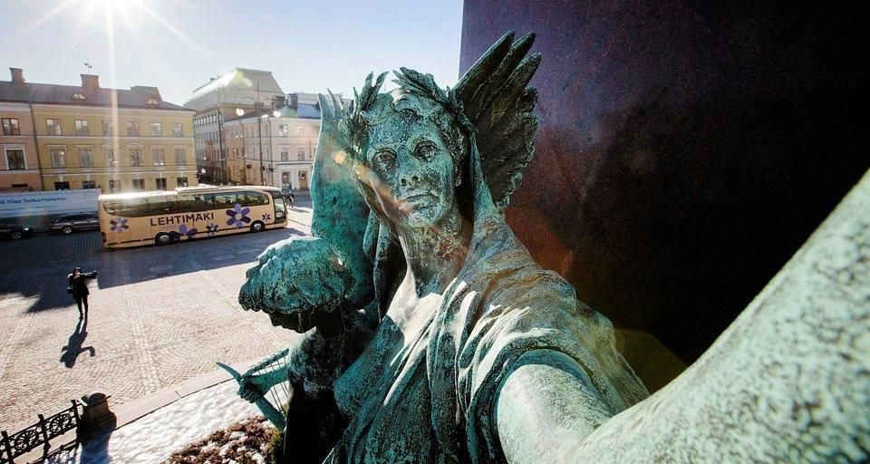 statues in our city taking selfie