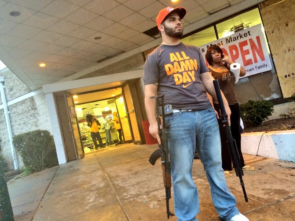 Ferguson shop owner showed up with two assault rifles after people beg